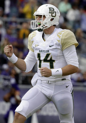 Photo - Baylor quarterback Bryce Petty (14) celebrates after completing a pass for a touchdown during the first half of an NCAA college football game against TCU, Saturday, Nov. 30, 2013, in Fort Worth, Texas. (AP Photo/LM Otero)