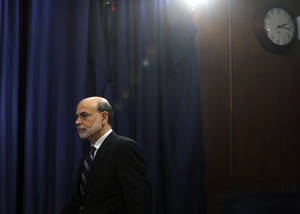 Photo - FILE - In this Wednesday, April 25, 2012, file photo, Federal Reserve Chairman Ben Bernanke arrives for a news conference at the Federal Reserve in Washington. The tumultuous Ben Bernanke era at the Federal Reserve moves toward its close with the final policy meeting of his eight-year tenure scheduled for the last week of January 2014.  (AP Photo/Susan Walsh, File)