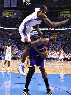 Photo - Oklahoma City's Serge Ibaka goes over the top of Los Angeles' Andrew Bynum to commit a foul during Game 2 in the second round of the NBA playoffs between the Oklahoma City Thunder and the L.A. Lakers at Chesapeake Energy Arena on Wednesday,  May 16, 2012, in Oklahoma City, Oklahoma. Photo by Chris Landsberger, The Oklahoman