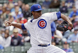 Photo - Chicago Cubs starter Edwin Jackson throws against the Milwaukee Brewers during the first inning of a baseball game in Chicago, Saturday, May 17, 2014. (AP Photo/Nam Y. Huh)