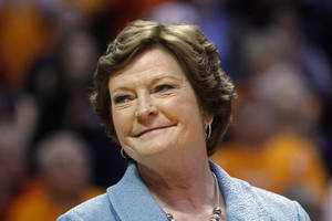 "Photo - FILE - In this Jan. 28, 2013 file photo, Tennessee head coach emeritus Pat Summitt smiles as a banner is raised in her honor before an NCAA college basketball game against Notre Dame, in Knoxville, Tenn. Summitt will remain the Tennessee women's basketball head coach emeritus next season and can continue holding the position as long as she wants it. That's according to a new contract signed in May and obtained Thursday night, July 3, 2014, through a public records request. It states that Summitt will have the title head coach emeritus ""in perpetuity, or until she chooses to relinquish it.""  (AP Photo/Wade Payne, File)"