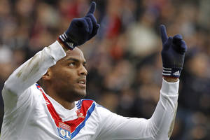 Photo - Lyon's Jimmy Briand celebrates after scoring a goal against Ajaccio during their French League One soccer match at Gerland stadium, in Lyon, central France, Sunday, Feb. 16, 2014. (AP Photo/Laurent Cipriani)