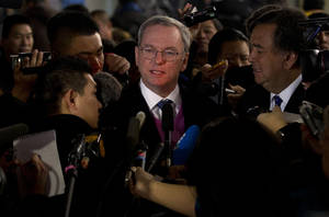 Photo - Google executive chairman Eric Schmidt, center, and former New Mexico Gov. Bill Richards, right, brief journalists after they arrived at Beijing Capital International Airport from Pyongyang, in Beijing Thursday, Jan. 10, 2013. Schmidt is urging North Korea to shed its self-imposed isolation and allow its citizens to use the Internet or risk being left behind economically. (AP Photo/Alexander F. Yuan)