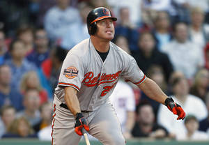 photo -   Baltimore Orioles' Jim Thome watches his ground-rule double that drove in the go-ahead run in the 12th inning of a baseball game against the Boston Red Sox in Boston, Saturday, Sept. 22, 2012. The Orioles won 9-6. (AP Photo/Michael Dwyer)