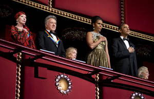 Photo - President Barack Obama, right, and first lady Michelle Obama, second from right, with the 2012 Kennedy Center Honors recipients, ballerina Natalia Makarova, left, and actor and director Dustin Hoffman, stand as the National Anthem is played during the Kennedy Center Honors Gala at the Kennedy Center in Washington, Sunday, Dec. 2, 2012. (AP Photo/Manuel Balce Ceneta)