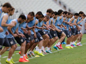 Photo - Uruguay's soccer team trains at Arena Castelao during the World Cup in Fortaleza, Brazil, Friday, June 13, 2014. Uruguay will play on June 14. (AP Photo/Fernando Llano)
