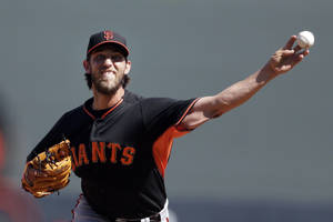 Photo - San Francisco Giants starting pitcher Madison Bumgarner pitches to a Colorado Rockies batter during the first inning of an exhibition spring training baseball game Tuesday, March 4, 2014, in Scottsdale, Ariz. (AP Photo/Gregory Bull)