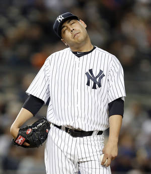 Photo - New York Yankees starting pitcher Vidal Nuno stretches his neck during the third inning of a baseball game against the New York Mets at Yankee Stadium in New York, Tuesday, May 13, 2014. (AP Photo)