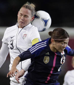 Photo -   Christie Rampone of the United States, left, fights for the ball with Japan's Nahomi Kawasumi during their women's friendly soccer match in Sendai, Japan, Sunday, April 1, 2012. (AP Photo/Shizuo Kambayashi)