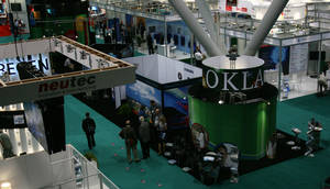 Photo - The Oklahoma BIO booth and the general display floor is shown Monday at the BIO International convention in Boston. PHOTO BY JIM STAFFORD      <strong>unknown</strong>