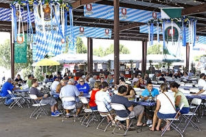 Photo - People enjoy food and beverages Monday under a pavilion during Oktoberfest in the Park in Choctaw. Photos By David McDaniel,The Oklahoman
