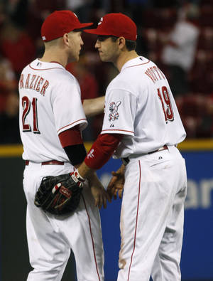 Photo -   Cincinnati Reds' Joey Votto and Todd Frazier congratulate each other after the Reds defeated the Milwaukee Brewers 4-2 in their baseball game in Cincinnati, Tuesday, Sept. 25, 2012. (AP Photo/Tom Uhlman)