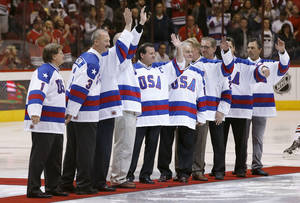 "Photo - Members of the gold medal 1980 ""Miracle on Ice"" U.S. Olympic hockey team are honored prior to an NHL hockey game between the Chicago Blackhawks and the Phoenix Coyotes, Friday Feb. 7, 2014, in Glendale, Ariz. (AP Photo/Ross D. Franklin)"