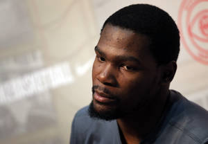 Photo -  Oklahoma City Thunder NBA basketball player Kevin Durant listens to a reporter during a press conference in Paris as part as a visit to France, Wednesday, Sept. 4, 2013.  (AP Photo/Christophe Ena)