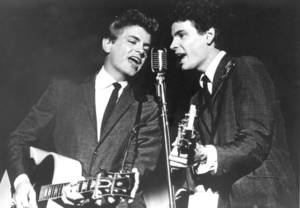 Photo - This July 31, 1964 file photo shows Don Everly and Phil Everly of The Everly Brothers during a performance. The Rock and Roll of Fame will honor the Everly Brothers with a tribute concert this fall. The Rock Hall announced Thursday that surviving member Don Everly will appear at the Oct. 25 event at PlayhouseSquare's State Theatre in Cleveland. Phil Everly died from chronic obstructive pulmonary disease earlier this year. The Everly Brothers were inducted into the Rock Hall in 1986 and the Country Music Hall of Fame in 2001. (AP Photo, File)