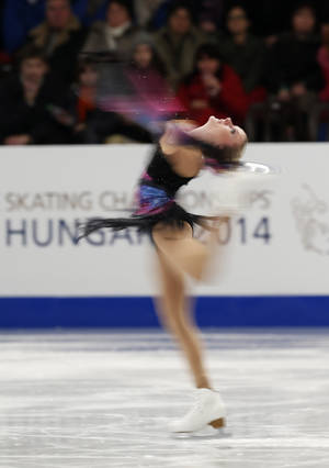 Photo - Sweden's Isabelle Olsson performs in the women's free skating at the European Figure Skating Championships in Budapest, Hungary, Friday, Jan. 17, 2014. (AP Photo/Darko Bandic)
