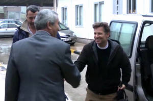 "Photo - In this image made from video, NBC chief foreign correspondent Richard Engel, right, shakes hands with an unidentified person after crossing back into Turkey, after they were freed unharmed following a firefight at a checkpoint after five days of captivity inside Syria, in Cilvegozu, Turkey, Tuesday, Dec. 18, 2012. Engel told the Turkish news agency Anadolu that he and his colleagues are ""very happy to be out"" and they are ""very tired."" (AP Photo/Anadolu via AP TV) TURKEY OUT, TV OUT"