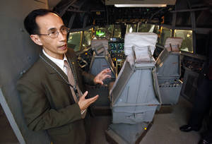 photo - Liem Vu, mission systems manager, gives a tour Thursday of a simulator inside Boeing's newest office building  in Oklahoma City.   Photo by Steve Sisney, The Oklahoman