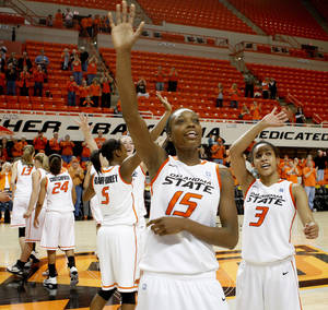 Photo - OSU's Toni Young (15) and Tiffany Bias (3) wave to the crowd after a first-round NIT women's college basketball game between Oklahoma State University (OSU) and Pepperdine at Gallagher-Iba Arena in Stillwater, Okla., Wednesday, March 16, 2011. Photo by Bryan Terry, The Oklahoman