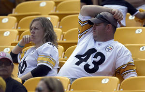 Photo - Pittsburgh Steelers fans watch from the stands as their team was losing to the Tennessee Titans in the fourth quarter of an NFL football game in Pittsburgh, Sunday, Sept. 8, 2013. The Titans won 16-9. (AP Photo/Gene J. Puskar)