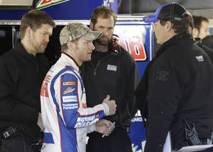 Photo - Driver Dale Earnhardt Jr., speaks to his crew after practice for Sunday's NASCAR Sprint Cup series auto race at the Martinsville Speedway in Martinsville, Va., Saturday, Oct. 26, 2013. (AP Photo/Steve Helber)