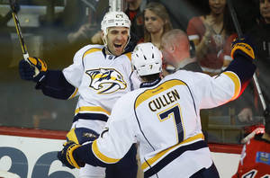 Photo - Nashville Predators' Eric Nystrom, left, celebrates his fourth goal with teammate Matt Cullen during third period NHL hockey action against the Calgary Flames in Calgary, Alberta, Friday, Jan. 24, 2014. The Calgary Flames beat the Nashville Predators 5-4 in a shootout. (AP Photo/The Canadian Press, Jeff McIntosh)