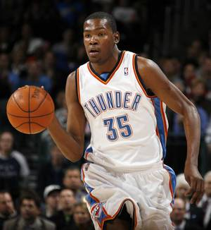 Photo - Oklahoma City's Kevin Durant dribbles the ball during the NBA basketball game between the Oklahoma City Thunder and the Houston Rockets at the Ford Center in Oklahoma City, Monday, Nov. 17, 2008. BY NATE BILLINGS, THE OKLAHOMAN ORG XMIT: KOD