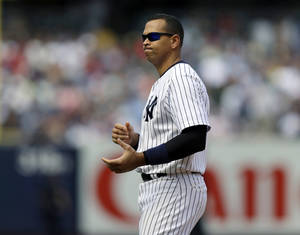 Photo - New York Yankees' Alex Rodriguez reacts after flying out to center field with Alfonso Soriano on second during the seventh inning of a baseball game against the Los Angeles Angels, Thursday, Aug. 15, 2013, in New York. (AP Photo/Kathy Willens)