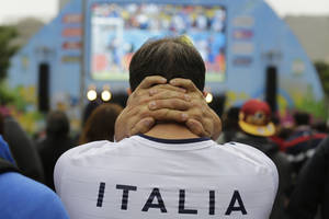 Photo - An Italy soccer fan watches his team's World Cup match with Costa Rica inside the FIFA Fan Fest area in Sao Paulo, Brazil, Friday, June 20, 2014. Italy lost 1-0 to Costa Rica. (AP Photo/Nelson Antoine)