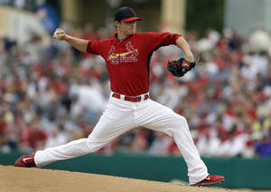 Photo - St. Louis Cardinals starting pitcher Shelby Miller throws during the first inning of an exhibition spring training baseball game against the Boston Red Sox Wednesday, March 5, 2014, in Jupiter, Fla. (AP Photo/Jeff Roberson)