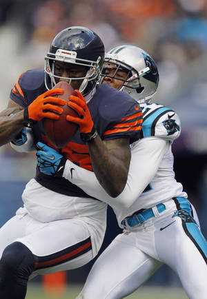 photo -   Chicago Bears wide receiver Brandon Marshall (15) is tackled from behind by Carolina Panthers defensive back Josh Norman (24) during the first half of an NFL football game in Chicago, Sunday, Oct. 28, 2012. (AP Photo/Charles Rex Arbogast)