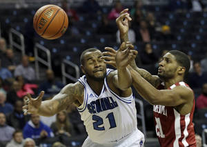 Photo - Seton Hall's Gene Teague (21) fights for control of the ball with Oklahoma's Cameron Clark (21) during the first half of a Coaches vs. Cancer NCAA college basketball game on Friday, Nov. 22, 2013, in New York. (AP Photo/Frank Franklin II)