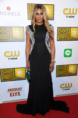 "Photo - FILE - In this June 19, 2014, file photo, Laverne Cox arrives at the Critics' Choice Television Awards at the Beverly Hilton Hotel on Thursday, June 19, 2014, in Beverly Hills, Calif. President Barack Obama during his first year in office became the first chief executive to say ""transgender"" in a speech, the first to name transgender political appointees and the first to prohibit job bias against transgender government workers. He also signed hate crime legislation that represented the first federal civil rights protections for transgender people in U.S. history. (Photo by Richard Shotwell/Invision/AP, File)"