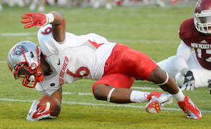Photo -   New Mexico's Jhurell Pressley makes a touchdown against New Mexico State during an NCAA college football game Saturday, Sept. 22, 2012, in Las Cruces, N.M. (AP PHOTO/Las Cruces Sun-News, Robin Zielinski)