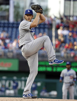 Photo - Los Angeles Dodgers starting pitcher Clayton Kershaw throws during the first inning of a baseball game against the Washington Nationals at Nationals Park, Tuesday, May 6, 2014, in Washington. (AP Photo/Alex Brandon)