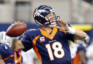 Photo - Denver Broncos quarterback Peyton Manning passes the ball against the Dallas Cowboys during the second quarter of an NFL football game Sunday, Oct. 6, 2013, in Arlington, Texas. (AP Photo/Sharon Ellman)