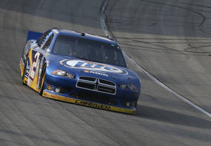 Photo -   Brad Keselowski drives through a turn during the NASCAR Sprint Cup Series auto race at Chicagoland Speedway in Joliet, Ill., Sunday, Sept. 16, 2012. Keselowski won the race. (AP Photo/Tim Stewart)