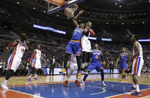 Photo - New York Knicks forward Amar'e Stoudemire (1), defended by Detroit Pistons center Andre Drummond, makes a basket during the first half of an NBA basketball game in Auburn Hills, Mich., Monday, March 3, 2014. (AP Photo/Carlos Osorio)