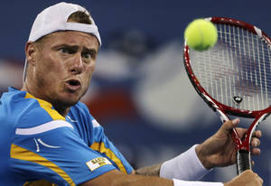 Photo - Lleyton Hewitt, of Australia, eyes the ball on a return against Juan Martin del Potro, of Argentina, during the second round of the 2013 U.S. Open tennis tournament, Friday, Aug. 30, 2013, in New York. (AP Photo/Charles Krupa)