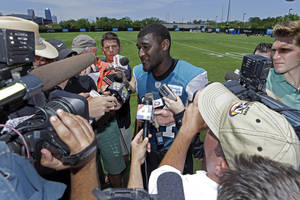 Photo - Jacksonville Jaguars wide receiver Justin Blackmon speaks with reporters after NFL football organized team activities, Monday, May 13, 2013, in Jacksonville, Fla. (AP Photo/John Raoux)