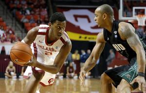 Photo - Oklahoma's Steven Pledger (2) looks to get past Ohio's Walter Offutt (3) during an NCAA college basketball game between the University of Oklahoma (OU) and Ohio at the Lloyd Noble Center in Norman, Saturday, Dec. 29, 2012. Photo by Bryan Terry, The Oklahoman