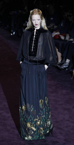 photo -   A model wears a creation part of the Gucci women's Fall-Winter 2012-2013 collection that was presented in Milan, Italy, Tuesday, Feb. 22, 2012.(AP Photo/Luca Bruno)