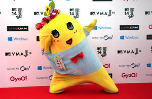 "Photo - FILE - In this June 14, 2014 file photo, Japanese mascot character ""Funassyi"" poses for photographers on the red carpet at MTV Video Music Awards Japan ceremony at Makuhari Amphitheater in Chiba near Tokyo. In a bright yellow, stretchy bodysuit, the pear-fairy jumps up and down frantically and talks in a rapid-fire, high-pitched voice, shouting ""nashi!"" (pear) at the end of each sentence. Funassyi appears regularly on TV and is releasing a CD from Universal Music Japan. The character reportedly earned 200 million yen ($2 million) last year. (AP Photo/Eugene Hoshiko, File)"