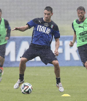 Photo - Italy's Mattia De Sciglio controls the ball during a training session in the rain, in Mangaratiba, Brazil, Tuesday, June 10, 2014. Italy will play in group D of the Brazil 2014 soccer World Cup. (AP Photo/Antonio Calanni)