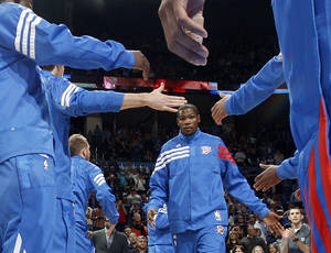Photo - NBA BASKETBALL: Oklahoma CIty's Kevin Durant is introduced before a preseason NBA game between the Oklahoma City Thunder and the Dallas Mavericks at Chesapeake Energy Arena in Oklahoma City, Tuesday, Dec. 20, 2011. Photo by Bryan Terry, The Oklahoman