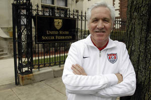 photo -   Tom Sermanni, new coach of the United States women's soccer team, poses for a photo outside the United States Soccer Federation Headquarters after an interview with The Associated Press, Tuesday, Oct. 30, 2012, in Chicago. Sermanni was hired Tuesday to replace Pia Sundhage, who led the Americans to back-to-back Olympic gold medals and their first World Cup final in 12 years. Sermanni has spent the last eight years as Australia's coach, taking the Matildas to the quarterfinals of the last two Women's World Cups. (AP Photo/M. Spencer Green)