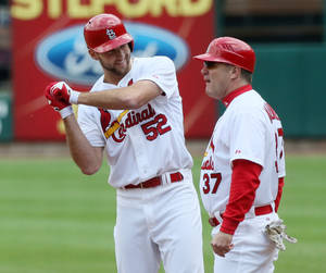 Photo - St. Louis Cardinals pitcher Michael Wacha gestures toward his teammates in the dugout after driving in two runs with a single in the second inning during a baseball game against the Chicago Cubs Thursday, May 15, 2014, at Busch Stadium in St. Louis. At right is first base coach Chris Maloney. (AP Photo/St. Louis Post-Dispatch, Chris Lee)