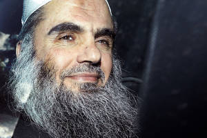 Photo - FILE - This is a  Tuesday, April 17, 2012 file photo,  of radical Islamist cleric  Abu Qatada as he  is driven away after being refused bail at a hearing at London's Special Immigration Appeals Commission, which handles deportation and security cases, in London. The British government on Monday Dec. 3, 2012 is challenging a court ruling that it cannot deport to Jordan the radical Islamist cleric Abu Qatada, who has been described by prosecutors as a key al-Qaida operative in Europe. (AP Photo/Matt Dunham, File)