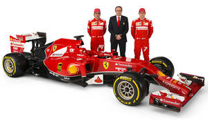 Photo - In this photo made available by Ferrari Media Saturday, Jan. 25, 2014,  Ferrari team principal Stefano Domenicali, center, poses with drivers Fernando Alonso, left, and Kimi Raikkonen near the new Ferrari F14 T Formula One car during the official presentation in Maranello, Italy. (AP Photo/Ferrari Photoservice)