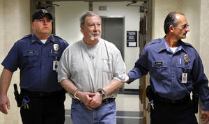 Photo -  Former pharmacist Jerome Jay Ersland is escorted by Corrections Department officers Nick Skinner, left, and Billy Atkinson to his sentencing Monday at the Cleveland County Courthouse.    <strong>Jim Beckel -  THE OKLAHOMAN </strong>